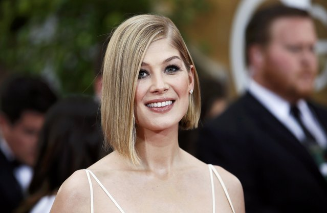 Actress Rosamund Pike arrives at the 72nd Golden Globe Awards in Beverly Hills, California January 11, 2015. (Photo by Danny Moloshok/Reuters)