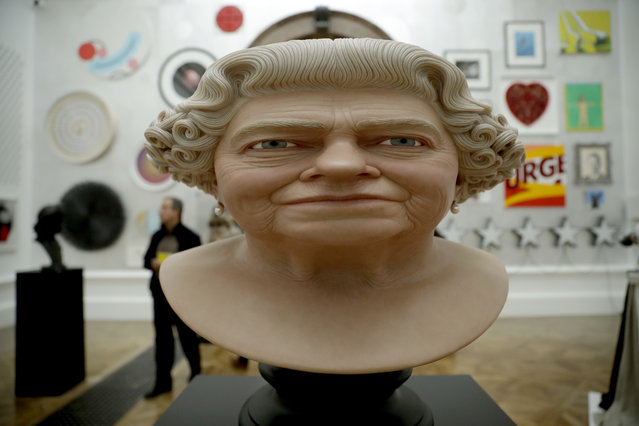 """The Queen"" painted fibreglass by artist John Humphreys is displayed backdropped by other works which feature in this year's Summer Exhibition on it's 250th year at the Royal Academy of Arts in London, Tuesday, June 5, 2018. The Summer Exhibition has been held since 1769, with around 1300 works on display this year and most of them available for purchase. It runs from June 12 until August 19. (Photo by Matt Dunham/AP Photo)"