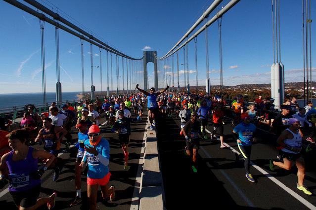 Runners cross the Verrazano–Narrows Bridge during the 2016 New York City Marathon in the Manhattan borough of New York City, U.S., November 6, 2016. (Photo by Brendan McDermid/Reuters)