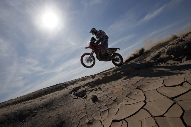Javier Pizzolito of Argentina rides during the sixth stage of the Dakar Rally 2015, from Antofagasta to Iquique, January 9, 2015. (Photo by Jean-Paul Pelissier/Reuters)