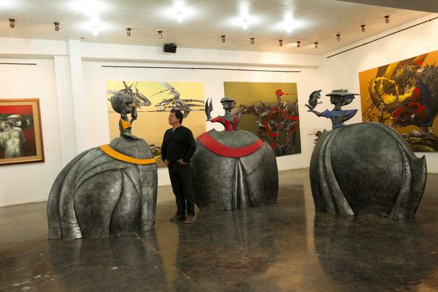 Ecuadorean painter Nicolas Herrera looks at his sculptures at his museum in Ibarra, Ecuador November 4, 2016. (Photo by Guillermo Granja/Reuters)