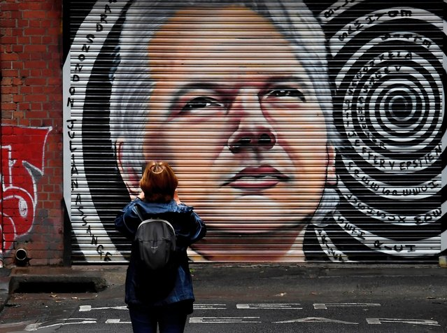 A mural of Australia's Julian Assange is seen in a laneway in Melbourne on January 5, 2021, after a judge in London ruled that the WikiLeaks founder should not be extradited to the US to face espionage charges for publishing hundreds of thousands of classified military and diplomatic documents in 2010. (Photo by William West/AFP Photo)