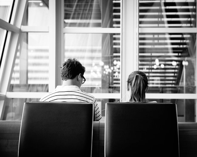"""iPod Love"". I saw this couple happily sharing an iPod while waiting for my flight in the Zurich airport. I thought it spoke well to technology and a little bit of love:) Location: Zurich, Switzerland. (Photo and caption by Angie McMonigal/National Geographic Traveler Photo Contest)"