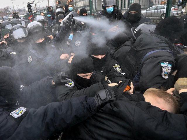 Ukrainian ultra-right protesters clash with while demanding to close the Nash TV channel, as they call it a TV channel for pro-Russian propaganda, in front of its office building in Kiev, Ukraine, 04 February 2021. Ukrainian President Volodymyr Zelensky on 02 February 2021 enacted a National Security and Defense Council decision to impose sanctions on Member of Parliament Taras Kozak and a number of TV channels Kozak owns, such as 112 Ukraine, NewsOne, and ZIK. After that, the channels were immediately disconnected from broadcasting. Commenting on the decision, Zelensky said he strongly supports the freedom of speech, but not propaganda financed by the aggressor country as UNIAN agency said. (Photo by Oleg Petrasyuk/EPA/EFE)