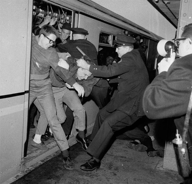 New York City policemen tangled with demonstrators at a subway station on the opening day of the New York World's Fair, April 22, 1964. Youths attempted to stall the train, which was headed from the city to the fairgrounds, as a form of protest on behalf of civil rights for blacks. (Photo by Charles Gorry/AP Photo)