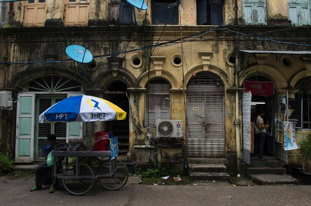 A colonial building is seen in Yangon on September 20, 2016. Myanmar cheered a US promise to end sanctions on September 15, 2016, with residents in its commercial capital clamouring for American brands while politicians and business moguls heralded a new era of transparency and trade. Myanmar cheered a US promise to end sanctions on September 15, 2016, with residents in its commercial capital clamouring for American brands while politicians and business moguls heralded a new era of transparency and trade. (Photo by Romeo Gacad/AFP Photo)