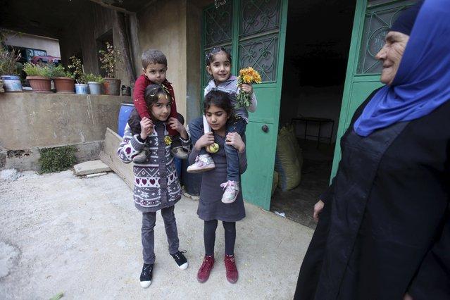 A Lebanese woman stands next to Lebanese children near a cannabis workshop in the Bekaa valley, Lebanon November 1, 2015. (Photo by Alia Haju/Reuters)