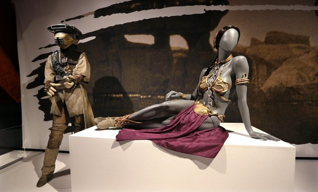 In this photo taken Thursday, January 29, 2015, Princess Leia's slave bikini, right, and her Boushh disguise are displayed as part of an exhibit on the costumes of Star Wars at Seattle's EMP Museum. (Photo by Elaine Thompson/AP Photo)