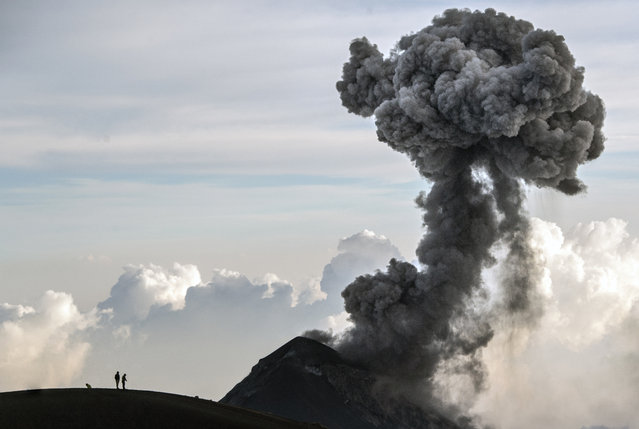 Hikers view Fuego Volcano as it erupts, from atop Acatenango summit in Acatenango, Guatemala on Tuesday, March 16, 2021. (Photo by Josh Edelson/AP Photo)