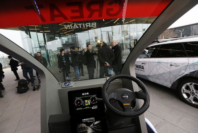 A prototype of a Lutz Pathfinder driverless vehicle is displayed to members of the media in Greenwich, east London, February 11, 2015. (Photo by Suzanne Plunkett/Reuters)