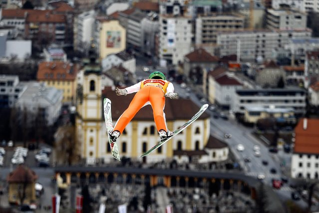 Peter Prevc of Slovenia soars through the air during a trial jump for the third jumping of the 64th four-hills ski jumping tournament in Innsbruck, Austria, January 2, 2016. (Photo by Dominic Ebenbichler/Reuters)