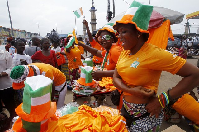 Fans buy national team merchandise ahead of the Ivory Coast's African Nations Cup final against Ghana, in Abidjan, February 8, 2015. (Photo by Luc Gnago/Reuters)