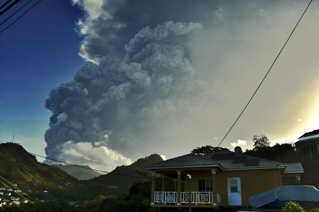 Ash rises into the air as La Soufriere volcano erupts on the eastern Caribbean island of St. Vincent, Tuesday, April 13, 2021. (Photo by Orvil Samuel/AP Photo)