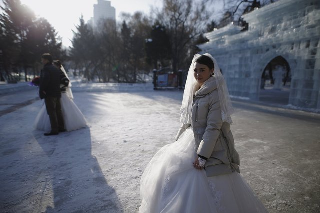 Newly-wed couples attend their group wedding ceremony which was held as part of the Harbin International Ice and Snow Festival in the northern city of Harbin, Heilongjiang province January 6, 2016. (Photo by Aly Song/Reuters)