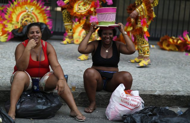 Revellers wait for the first night of the Carnival parade of samba schools in Rio de Janeiro's Sambadrome February 15, 2015. (Photo by Pilar Olivares/Reuters)