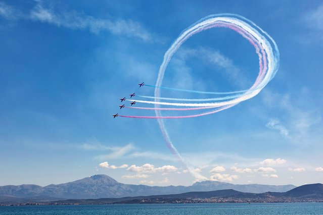 """A handout photo made available by the Ministry of National Defence shows the Royal Air Force Aerobatic Team """"Red Arrows"""" performing over Tanagra Air Base, during pre-season training known as Exercise Springhawk, Tanagra, Greece, 28 April 2021. (Photo by Ministry of Defence/EPA/EFE)"""