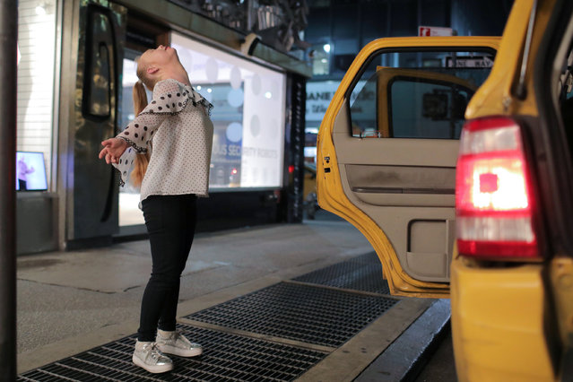 Model Madeline Stuart, who has Down's syndrome, celebrates after stepping out of a taxi cab as she arrives for New York Fashion Week in New York City, U.S., September 5, 2018. (Photo by Andrew Kelly/Reuters)