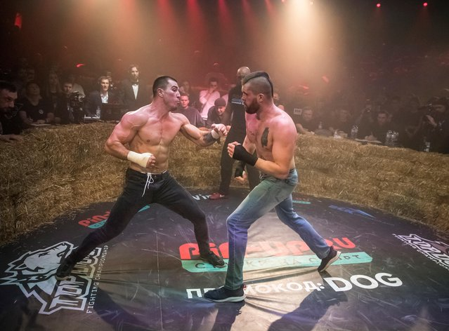 """Rustam """"Asteroid"""" and Anton """"Charon"""" fight during the """"Top Dog"""" bare-knuckle boxing tournament in Moscow, Russia on April 16, 2021. (Photo by Shamil Zhumatov/Reuters)"""