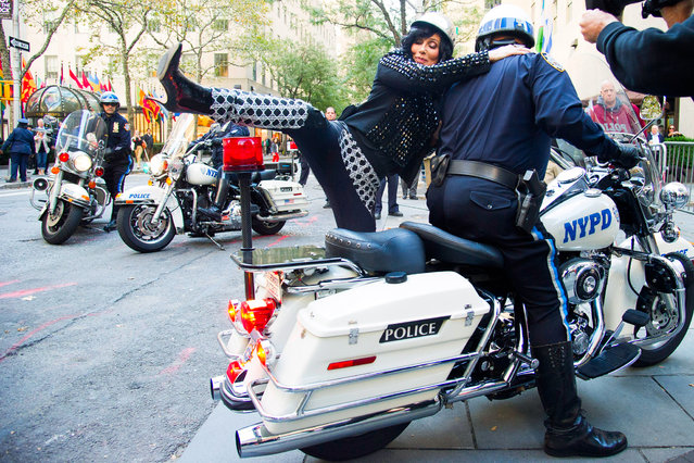 """Cher arrives by police motorcycle for her performance on NBC's """"Today"""" show on Monday, September 23, 2013 in New York. (Photo by Charles Sykes/AP Photo/Invision)"""