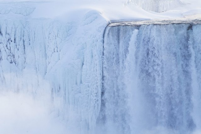 "Masses of ice form around the Canadian ""Horseshoe"" Falls as seen from Niagara Falls, Ontario, Canada, Thursday, February 19, 2015. (Photo by Aaron Lynett/AP Photo/The Canadian Press)"