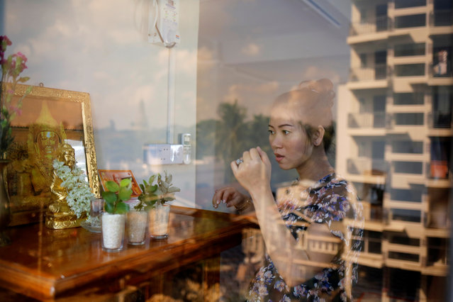 Pan Ei Mon, the wife of detained Reuters jouranlist Wa Lone, prays at home in Yangon, Myanmar on August 8, 2018. (Photo by Ann Wang/Reuters)