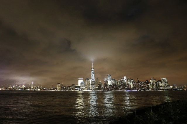 Low clouds are seen over the New York City skyline following an evening of light showers seen from Liberty State Park, Tuesday, December 22, 2015, in Jersey City, N.J. (Photo by Julio Cortez/AP Photo)