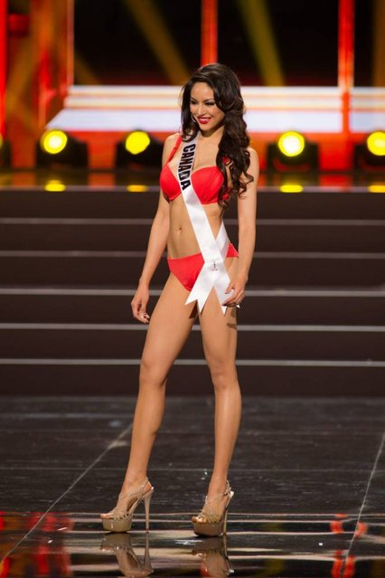 A handout picture provided by the Miss Universe Organization shows Riza Santos, Miss Canada 2013, competing in the swimsuit competition during the Preliminary Competition at the Crocus City Hall, in Moscow, Russia, 05 November 2013. (Photo by Darren Decker/EPA)