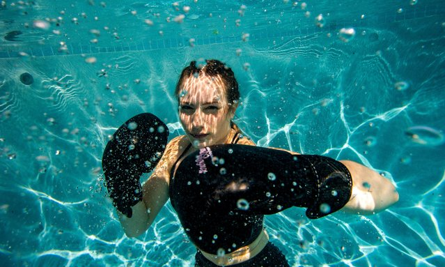 Professional Boxer Shayna Foppiano poses and practices her boxing skills underwater on June 18, 2021 in Saugus, Massachusetts. Foppiano is working her way up the ladder to a major prize fight, she may have been there by now if it hadn't been for the Covid-19 pandemic. (Photo by Joseph Prezioso/ZUMA Wire/Rex Features/Shutterstock)
