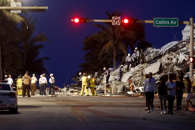 Emergency crews respond to a partially collapsed residential building in Surfside, near Miami Beach Florida, U.S. June 24, 2021. (Photo by Marco Bello/Reuters)