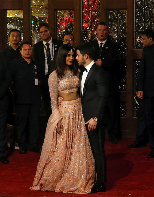 Actress Priyanka Chopra and her husband Nick Jonas arrive to attend the wedding ceremony of Isha Ambani, the daughter of the Chairman of Reliance Industries Mukesh Ambani, in Mumbai, India, December 12, 2018. (Photo by Francis Mascarenhas/Reuters)