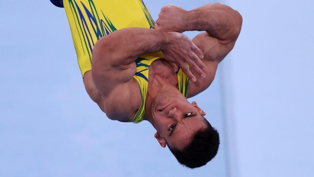 Caio Souza of Team Brazil competes on vault during Men's Qualification on day one of the Tokyo 2020 Olympic Games at Ariake Gymnastics Centre on July 24, 2021 in Tokyo, Japan. (Photo by Mike Blake/Reuters)