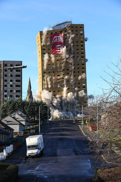 Handout photo issued by GHA of a multi-storey block of Glasgow Housing Association flats at 20 Rosemount Street in Roystonhill, Glasgow, brought to the ground in five seconds using 40kg of explosives to make way for new homes, on December 1, 2013. (Photo by John Young/PA Wire)