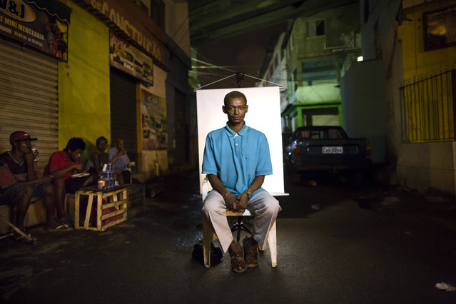 "In this March 14, 2015 photo, Jorge, 35,  poses for a portrait in an open-air crack cocaine market, known as a ""cracolandia"" or crackland, where users can buy crack, and smoke it in plain sight, day or night, in Rio de Janeiro, Brazil. Teenage mothers, truck drivers, fathers, homeless, those struggling with mental illness – all manner of person can be found in Rio's cracklands. (Photo by Felipe Dana/AP Photo)"