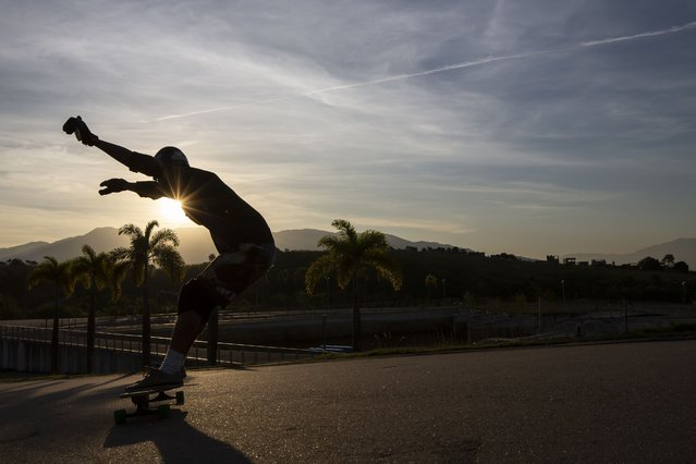 A man rides a skateboard at Radical Park in Rio de Janeiro, Brazil, Thursday, June 24, 2021. Hundreds of joggers, dog walkers, skateboarders and picnicking families come each day. (Photo by Bruna Prado/AP Photo)