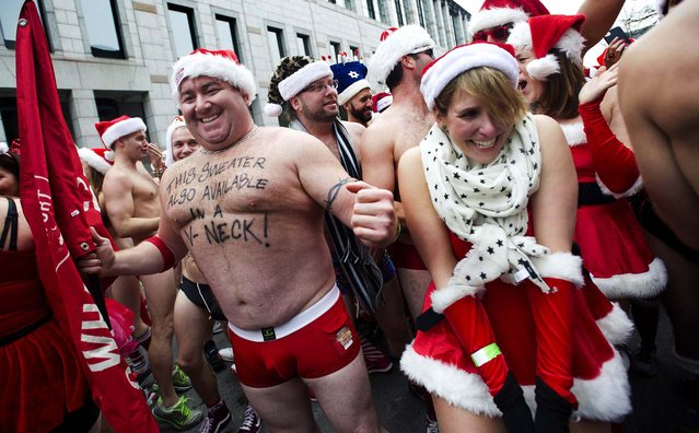 """Runners gather at the start line for the annual """"Santa Speedo Run"""" in Boston. (Photo by Gretchen Ertl/Reuters)"""