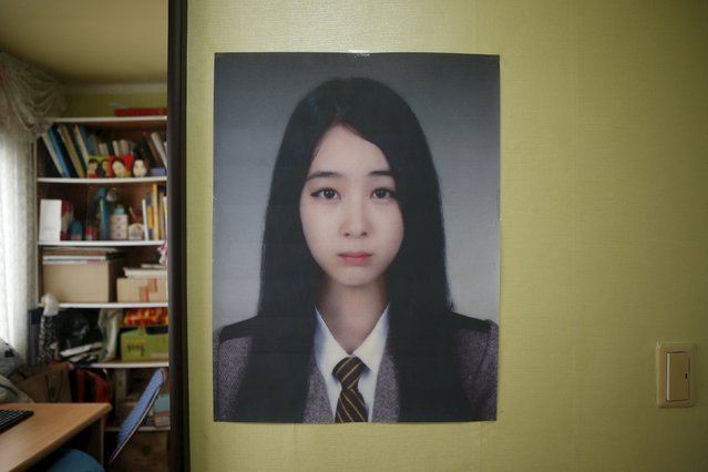 A picture of Moon Ji-sung, a high school student who died in the Sewol ferry disaster, hangs in her room in Ansan April 7, 2015. Her dream was to be a flight attendant. (Photo by Kim Hong-Ji/Reuters)