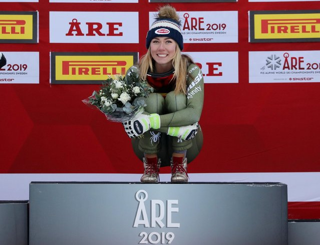 The US' winner Mikaela Shiffrin celebrates during a flowers ceremony after the women's Super G event of the 2019 FIS Alpine Ski World Championships at the National Arena in Are, Sweden, on February 5, 2019. (Photo by Denis Balibouse/Reuters)