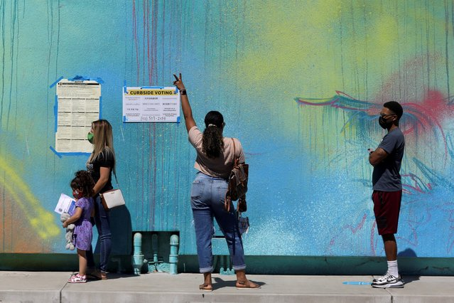 A woman gestures as people wait to vote in the California gubernatorial recall election outside the Museum of Latin American Art (MOLAA) in Long Beach, California, U.S., September 14, 2021. (Photo by David Swanson/Reuters)