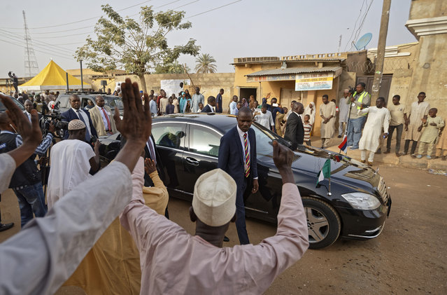 Supporters cheer as President Muhammadu Buhari leaves in his car after casting his vote in his hometown of Daura, in northern Nigeria Saturday, February 23, 2019. Nigerians are going to the polls for a presidential election Saturday, one week after a surprise delay for Africa's largest democracy. (Photo by Ben Curtis/AP Photo)