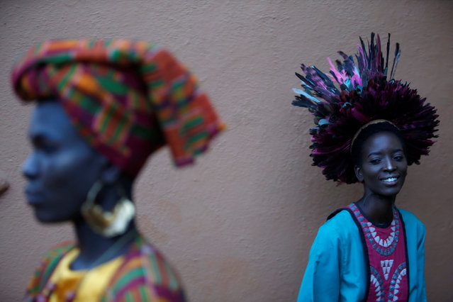"Models wait behind the scenes before a fashion show featuring African fashion and culture during a gala marking the launch of a book called ""African Twilight: The Vanishing Rituals and Ceremonies of the African Continent"" at the African Heritage House in Nairobi, Kenya on March 3, 2019. (Photo by Baz Ratner/Reuters)"