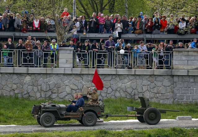 Enthusiasts take part in a re-enactment battle between the Soviet Red Army and German troops during the 70th anniversary of the liberation of Ostrava, in Ostrava, Czech Republic, April 30, 2015. (Photo by Laszlo Balogh/Reuters)
