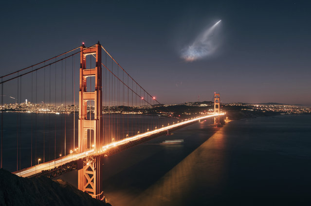 In this photo taken Sunday, October 7, 2018 and provided by Justin Borja, a SpaceX Falcon 9 rocket launch is seen in the distance over the Golden Gate Bridge near Sausalito, Calif. When SpaceX launched a rocket carrying an Argentine Earth-observation satellite from California, both the night sky and social media lit up. People as far away as Phoenix and Sacramento posted photos of the rocket returning to its launch site on Sunday night in what was the first time SpaceX landed a first-stage booster back at its launch site at Vandenberg Air Force Base. (Photo by Justin Borja via AP Photo)