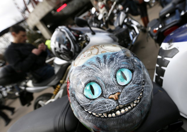 "A helmet lies on a motorbike before motocross in honor of the 70th anniversary of the Victory over Nazi Germany in the World War II, in Moscow, Russia, April 25, 2025. Russian biker group the Night Wolves, known to be firm supporters of President Vladimir Putin, are planning the so-called ""victory journey"" from Moscow to Berlin to mark the Soviet Red Army's victory over Nazi Germany at the end of World War II. (Photo by Yuri Kochetkov/EPA)"