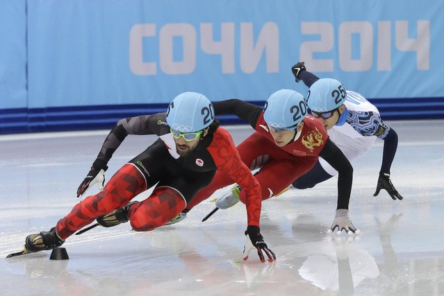 Charles Hamelin of Canada, left, Han Tianyu of China, centre, and Victor An of Russia compete in a men's 1500m short track speedskating final at the Iceberg Skating Palace during the 2014 Winter Olympics, Monday, February 10, 2014, in Sochi, Russia. (Photo by Darron Cummings/AP Photo)