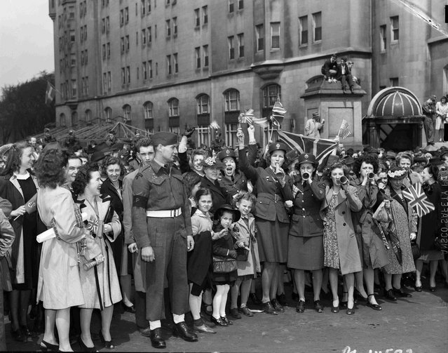 A crowd celebrates at the Victory Loan Indicator, Confederation Square, on VE-Day in Ottawa, Ontario, May 8, 1945, in this handout photo provided by Library and Archives Canada. (Photo by Chris Lund/Reuters/National Film Board of Canada/Library and Archives Canada)