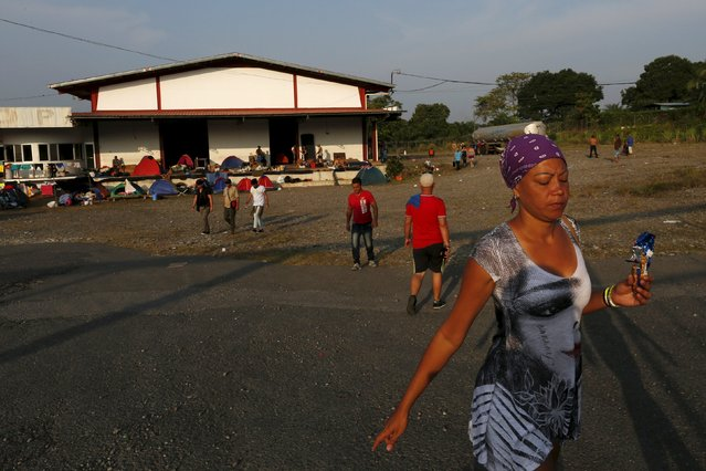 A Cuban migrant walks in front  of a provisional shelter in Paso Canoas, border with Costa Rica, in Panama March 21, 2016. (Photo by Carlos Jasso/Reuters)