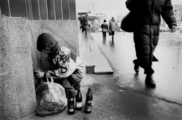 While the children are asleep Ruslana, 13, collects hidden bottles to be exchanged for cash, 2002. Originally from the Carpathians, Ruslana and her two siblings were abandoned at a rail station in Kiev three years ago as the family was moving to Russia. The children have been secretly saving money in hopes of travelling to Russia to find their sister who left no address or phone number. (Photo by Kurt Vinion /Getty Images)