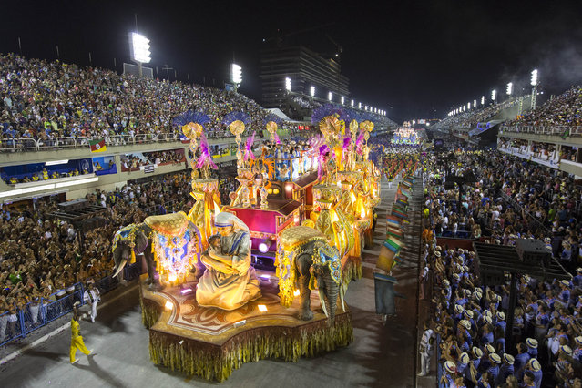 Performers from the Sao Clemente samba school parade on a float during carnival celebrations at the Sambadrome in Rio de Janeiro, Brazil, Monday, March 3, 2014. (Photo by Felipe Dana/AP Photo)