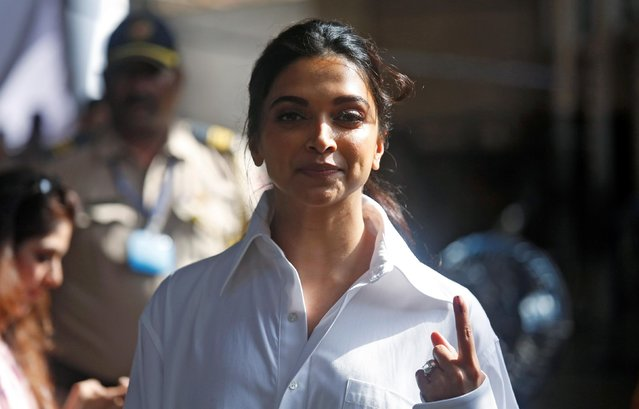Bollywood actor Deepika Padukone shows an ink mark on her finger after casting her vote at a polling station in Mumbai, India April 29, 2019. (Photo by Francis Mascarenhas/Reuters)