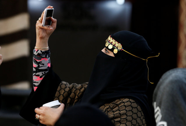 A woman takes a selfie during Janadriyah Cultural Festival on the outskirts of Riyadh, Saudi Arabia February 8, 2017. (Photo by Faisal Al Nasser/Reuters)